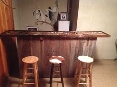this is a bar I am working on. bartop still needs about 2 gallons of epoxy. bar was made from old barn siding from our family farm. bartop is made from an old oak plank cut when my dad was a boy, it's about 60 years old. I filled it with relics from the farm horseshoes and such, old ammo, antique cap guns flint arrows and old saloon gambling items.