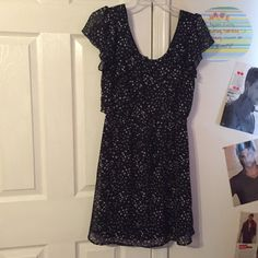 Nice dress with hearts This is a really nice business dress with hearts all over. The back is like a V so it's really cute! It's like a thicker tank top dress, with see through flowy sleeves. The waistline comes together and makes it look really nice! It's also in perfect condition. Dresses Midi