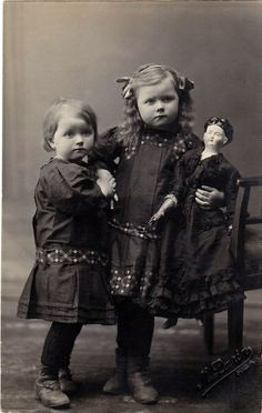 Antique photo by Cat Gabriel Art, via Flickr. girls holding early doll