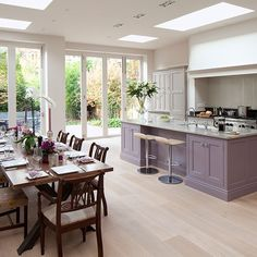 Spacious grey and purple kitchen-diner with oak wood floor | kithen decorating