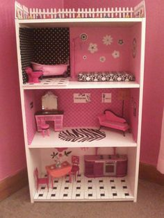 Barbie house made out of a bookshelf I made for my daughter for Christmas. Best present ever!