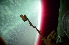 Magical lights dance across Earth's atmosphere in this collection of images of auroras seen from the International Space Station and beyond.