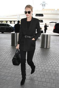 All Balck - belt your jacket How to Layer Like Rosie Huntington-Whiteley via @WhoWhatWear