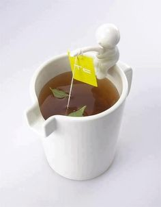 "Creative tea mug with little guy ""fishing"" as his pole holds the tea bag :)"