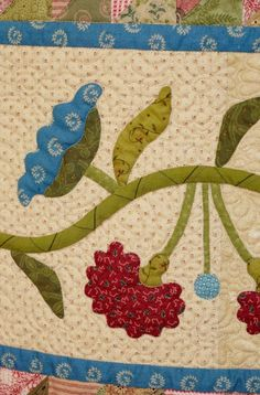 """Detail of my """"Garden Girl"""" quilt hanging at 3 Dudes Quilting, featured as one of the top quilt shops in the Spring 2015 Quilt Sampler magazine