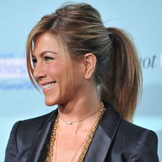 """Jennifer Aniston's ponytail looks as perfect with a tank as it does with a tux. The secret to its versatility? """"We keep the sides super-sleek and add piecey volume to the crown,"""" explains her hairstylist, Chris McMillan. To get the look, gather hair into a low pony and secure with a thick elastic. Then split the tail in two and pull both ends to tighten the sides and loosen the roots."""