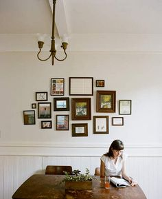 picture frames on the wall by allisonadderton, via Flickr Dining room