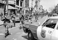 April 7, 1968-National Guardsmen march along the 1900 block of Greenmount Avenue following the riots that took place in the streets of Baltimore after the assassination of Dr. Martin Luther King, Jr. (William L. LaForce, Jr./Baltimore Sun)