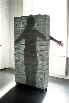 A prototype wall of translucent concrete is shown at the National Building Museum. When backlit, a human form can be seen through the wall. The blocks are made by mixing glass fibers into the combination of crushed stone, cement and water. Concrete Furniture, Concrete Art, Concrete Projects, Concrete Design, Bureau Design, Transparent Concrete, National Building Museum, Building Concept, Construction Materials
