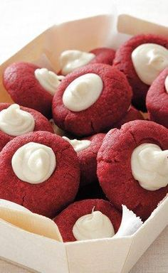 These little red velvet bundles of joy are filled with a to-die-for white chocolate mixture for a flavor (and color) combo that's out of this world. This is one of Betty's most-Pinned recipes of all time, so make sure you add this one to your cookie exchange list! You only need nine ingredients. Just Desserts, Delicious Desserts, Cookie Desserts, Dessert Recipes, Yummy Food, Cheesecake Cookies, Baking Cookies, Xmas Desserts, Tasty Cookies