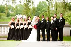 Kind of like the theme here with the black dresses/white bouquets and the red bouquet for the bride