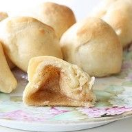 marshmallows dipped in melted butter, then rolled in cinnoman sugar, wrapped in a cresent roll, and baked:)