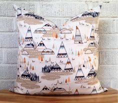 This listing is for one adorable pillow cover in a fresh and modern teepee and trees print in taupey grey, peach, navy and touches of aqua blue.