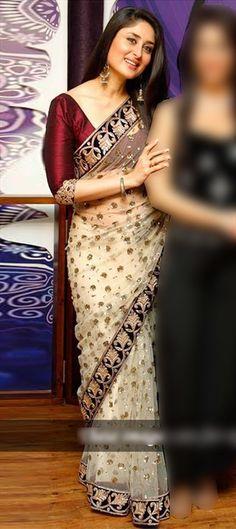 Kareena wore a nude net Manish Malhotra sari when she unveiled her wax statute at Madame Tussauds.