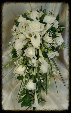 traditional and classic shower bouquet with calla lilys, roses, dendrobium orchids and lily of the valley with diamante detail. stylish and ideal for a modern bride. www.weddingflowersbylaura.com