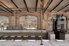 backsplash, concrete counters, large chains, lighting from below, exposed brick