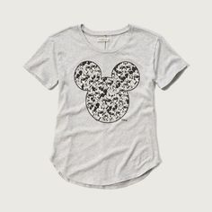 Abercrombie & Fitch Disney Graphic Tee ($34) ❤ liked on Polyvore featuring tops, t-shirts, light grey, graphic tops, curved hem t shirt, abercrombie fitch top, crewneck tee and crewneck t-shirt