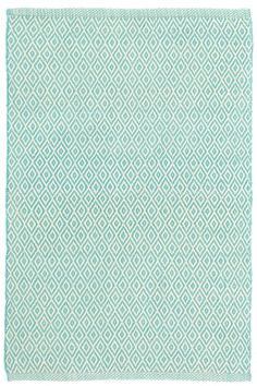 Create a cool, relaxed atmosphere with this eco-friendly, recycled polyester indoor/outdoor rug featuring a subtle diamond pattern in a refreshing aqua. Mix and match with our  Stone Soup and  Neapolitan indoor/outdoor rugs.