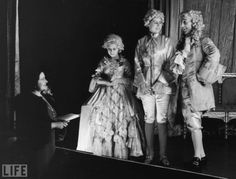 Queen Elizabeth (the current queen's mother), Princess Margaret, and Princess Elizabeth rehearse Cinderella in that first royal Christmas pantomime at Windsor Castle on Dec. 21, 1941.