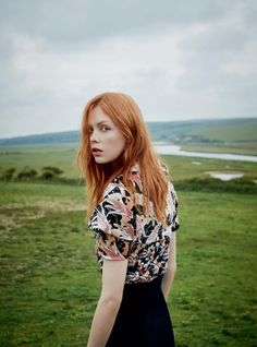 Posing outdoors, Dani Witt models velvet top and crepe skirt from Dior
