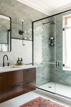 Image result for glass tiled wall in bathroom with walnut cabinets