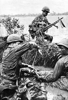 """1st Infantry Division Medic treating a wounded Grunt."" ~ Vietnam War"