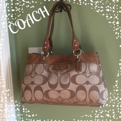"""Coach Penelope Sign. """"C"""" Sateen Shopper Pre-Loved Condition!!!  Snakeskin like leather trim. Coach logo and hangtag, silver hardware, magnet snap closure, rear exterior zip pocket, metal feet on bottom, dual shoulder straps w/8"""" drop. Interior 2 main compartments with zip pocket in middle, also side zip and 2 slip pockets. Measures 14""""x8.5""""x4.5"""". Plz note: pre-loved, small amount of wear on corners, a few light stains, no ink marks. Selling """"as is"""". Price reflects. Lots of life left…"""