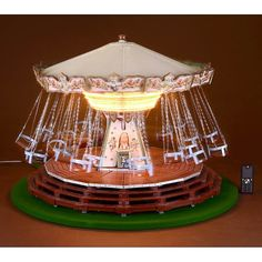 Fairground Working Model of a Chain Carousel Constructed of wood, metal and canvas, hand-painted finish with decals, with 22 seats, electric motor and light Merry Go Round Carousel, Diy Projects For Beginners, Diy Chicken Coop, Real Plants, Fun Hobbies, Thing 1, Dollhouse Furniture, Handmade Toys, Outdoor Gardens
