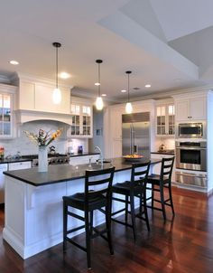 Obsessed with white cabinets in the kitchen. I would just add a color on the walk
