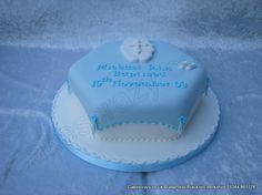 Hexagon blue sugar blanket covering Baptism cake