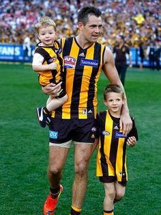 Hawthorn wins 2014 premiership | Herald Sun | Norm Smith medallist Luke Hodge with his children. Picture: Wayne Ludbey
