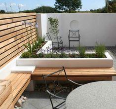terraza moderna piedras banco madera