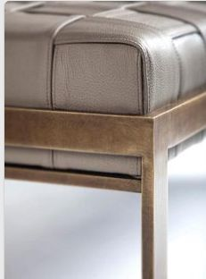 Basket weaved leather combined with hard metal.