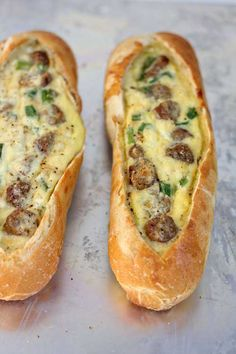 Recipe for Sausage Egg Boats - These egg boats are a new breakfast favorite because they literally take less than five minutes to prep. Sourdough baguettes filled with sausage, eggs and lots of cheese, baked until hot and toasty… so so good!