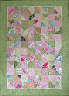 I like this idea of making a quilt from baby clothes you can't part with!
