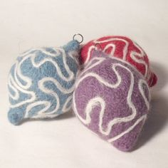 easy free hand needle felting onto knitted and felted baubles using sparewhite knitting ayrn