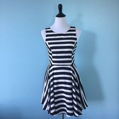 B&W Striped Dress Beautiful black and white striped dress, size 11, has some stretch, very comfortable, zip in back. The patterns of the stripes make the waist look super small :) My Michelle Dresses