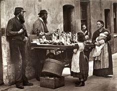 "From 'Street Life in London', 1877, by John Thomson and Adolphe Smith:  'The accompanying photograph represents a street group gathered round a dealer whose barrow is one of the most attractive I have seen during my wanderings about town. The story of its owner was narrated to me in the following words :- [...] ""There are now too many 'swags' and most of them ain't the gentlemen they used to be. I should say there are 1500 'swag' dealers about London, counting women, boys, and girls. The…"