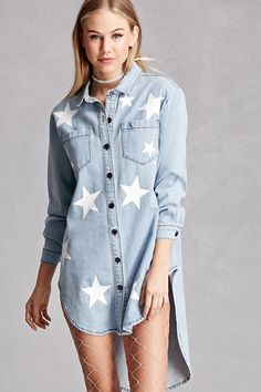A denim shirt dress featuring a star graphic print, a button-front, basic collar, long buttoned cuff sleeves, front patch pockets, and a rounded high-low hem. This is an independent brand and not a Forever 21 branded item.