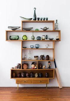 Alex has collected art glass for years, mainly Scandanavian and some Italian- this is part of his collection. The Toby Jugs are Bendigo Pottery – 'Alex was given a Toby Jug every birthday since he was born' says Georgie. Photo -Sean Fennessy, production – Lucy Feagins / The Design Files.