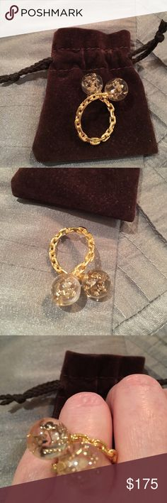 Louis Vuitton Gold ring Authentic Louis Vuitton Gold Ring. This piece is a rare LV piece of jewelry. It wraps around the finger and has two clear balls with LV symbols inside! Louis Vuitton Jewelry Rings