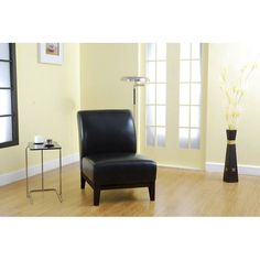 Relax comfortably in this stylish armless black leather chair. This sleek black chair features a lovely walnut wood frame suitable for any room, and it will easily match your existing decor.