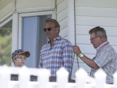Actor Kevin Costner stands on the porch of the house at the Field of Dreams movie site with original home owner Don Lansing, right, and Cost. Movie Sites, Field Of Dreams, Kevin Costner, Iowa Hawkeyes, Porch, Pride, Men Casual, Actors, Sweet