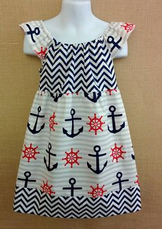 Red, White, and Blue Anchors Away Flutter Sleeve dress!  This dress has great versatility. You can dress your little princess up in it for the 4th of July but she could also wear it throughout the summer.  More colors of this fabric also Yellow/grey and Red/Black.  Size Shown: 5T Available to be purchase for $25.00 Available to be made in 6/9mo-8