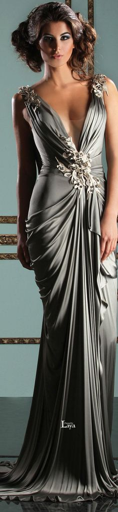 Medium Grey Evening Gown w. Petal Bejewelled Frills on the Front of Her Gown. Mereille Dagher.