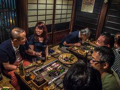 "The rakugo (comic storytelling) performance in ""Sakurada"" (http://www.sakurada.tv/index.html) is over and people enjoy their old-school barbeque (coal and everything); like many Asakusa restaurants, the size of the place makes mingling easier -and fun! 2/3 #Asakusa, #Sakurada, #barbeque July 19, 2014 © Grigoris A. Miliaresis"