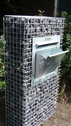 Gabion Wall, Baskets, and Fences How To Use Them In The Garden Have you ever heard of gabion baskets Gabion Wall Design, Fence Design, Gabion Retaining Wall, Gabion Baskets, Baskets On Wall, Garden Furniture, Backyard Landscaping, Outdoor Gardens, Landscape Design
