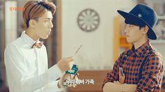 Our maknae feeding Baek hyung with pepero <3 I'm screaming, inderect kisss XD