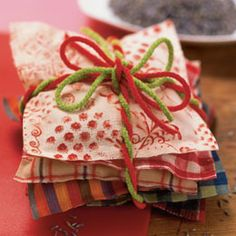 Gifts don't need to be anything more than thoughtful.  These Christmas sachets are perfect for teachers or neighbors and easy enough for your kiddo's to do.  Use 5 inch fabric squares, glue them together, fill with 1/2 cup of poupori and glue closed.  Bundle fun fabrics together and deliver them with a sweet note.