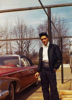 Candid photograph of Elvis Presley at the back of Graceland, March 20, 1960.